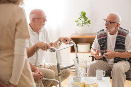 Two senior man during coffee brake in nursing home