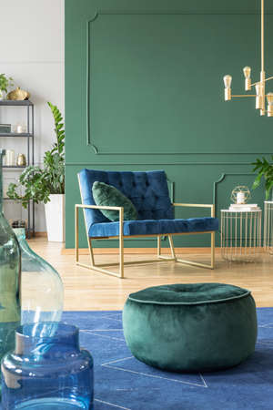 Green velvet pouf in modern living room interior 写真素材