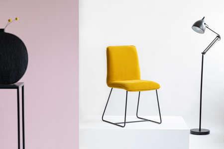 Chair on white platform in fashionable abstract interior Stockfoto - 123113747