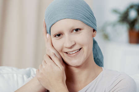 Smiling happy woman with cancer supported by caregiver after chemotherapy