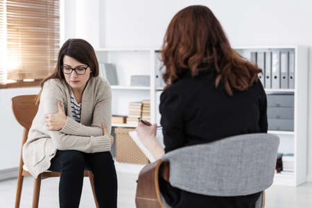 Woman with problem and supporting counselor during therapy session