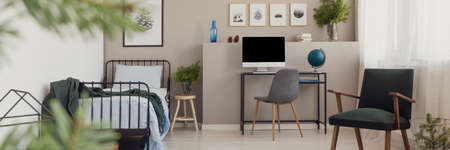 Panoramic view of grey teenager room with armchair
