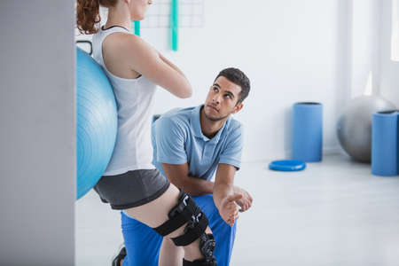 Professional personal trainer and sportswoman exercising with ball Stock Photo