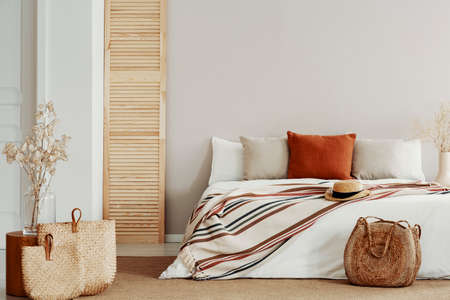 Natural bright bedroom with autumn accents, copy space on white empty wall Stock Photo - 124431877