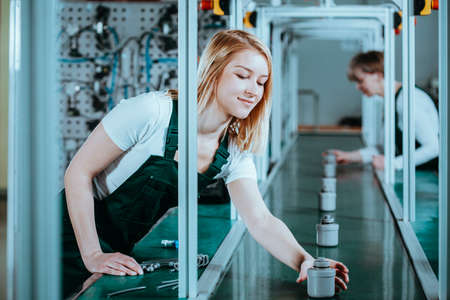Hardworking focused professional motivated female factory worker