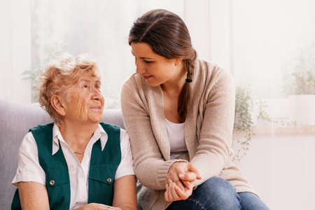 Senior woman and helpful volunteer at nursing home Stock Photo