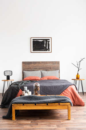 Vertical shot of a classic bedroom with colorful natural decor