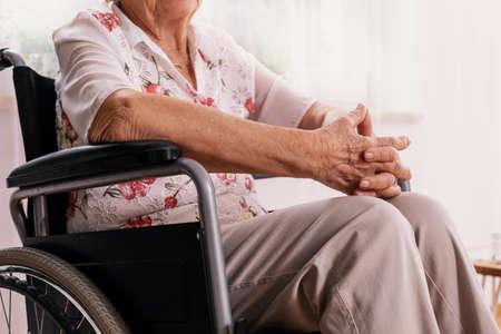 Elderly woman sitting on wheelchair at nursing home