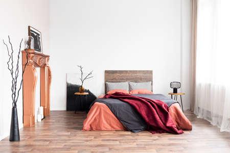 Natural decor in bright minimal bedroom full of daylight Stock Photo