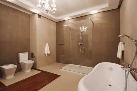 Trendy beige, wooden and white bathroom interior Stock Photo - 124577351