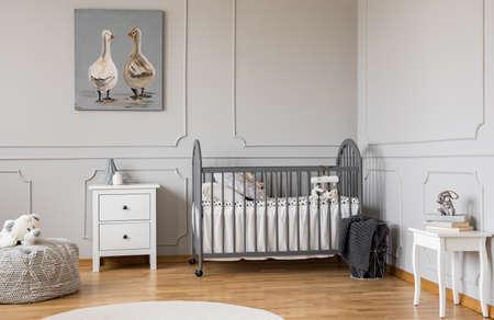 Trendy grey baby room design in tenement house, copy space on empty wall Stock fotó