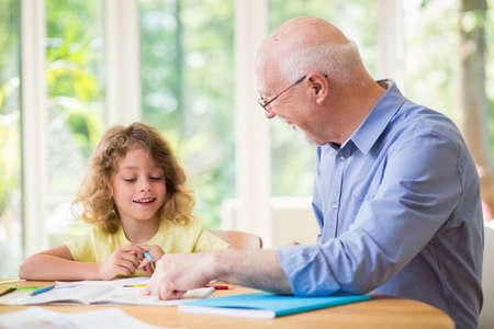 Man and his grandchild doing homework after school