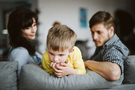 helpless parents and their badly behaving son at home