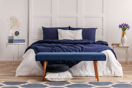 Navy blue bedroom interior in scandinavian apartment Banco de Imagens