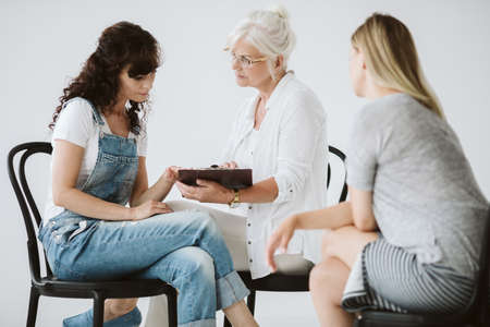 Older woman talking with young woman about the plan