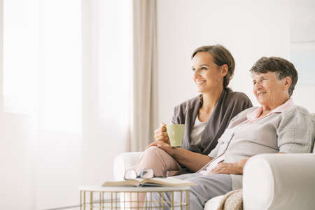Young woman spending time with her older grandmother