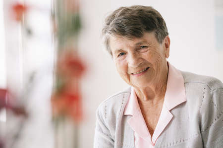 Portrait of happy senior woman in a nursing home