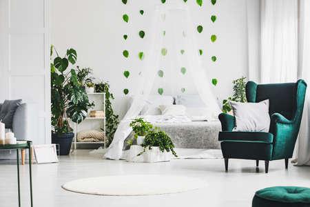 Trendy wing back chair in fancy bedroom interior with elegant furniture 版權商用圖片 - 128922868