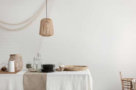 Dining room with wicker lamp, tray and basket Stock Photo