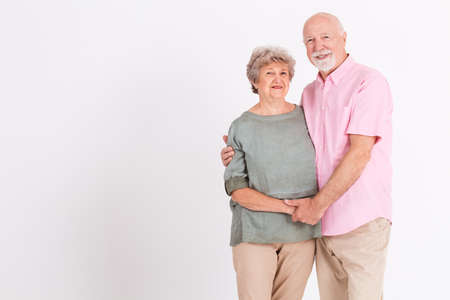 Portrait of happy older married couple posing together