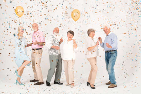 Senior married couples dancing together at the party