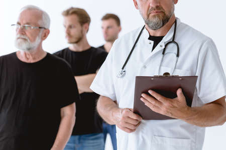 Close up of the doctor reading the diagnosis to the group of men