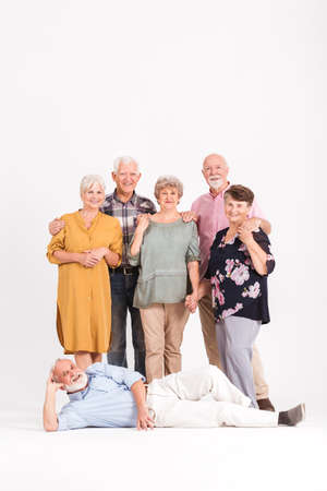 Older happy people on a family portrait together