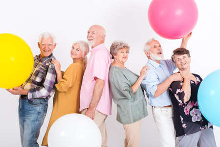 Group of older people having fun together