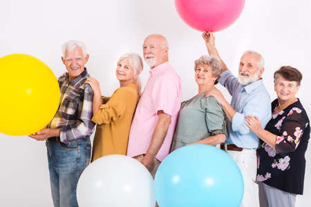 Older married couples dancing in a line at the party Standard-Bild - 129347636
