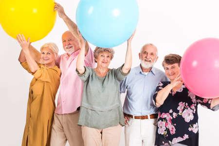 Group of senior friends having a party Standard-Bild - 129347648
