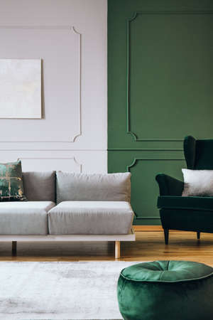 Stylish living room interior with trendy sofa with pillows, real photo Imagens