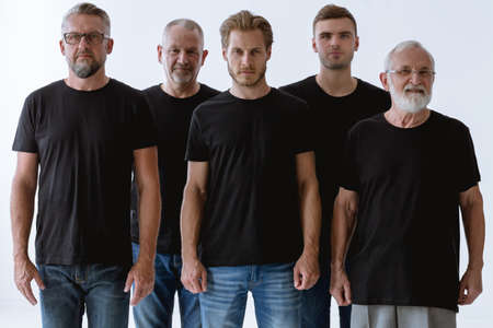 Group of strong men in black t-shirt on a white background