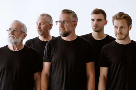 Group of men in black in different age protesting together