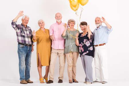 Senior friends celebrating women's birthday Standard-Bild - 129348273