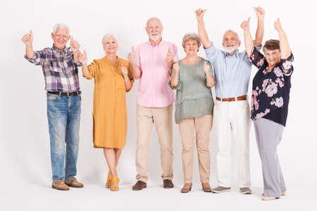 Group of senior people holding thumbs up Standard-Bild - 129348343
