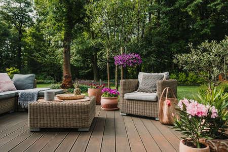 Elegant garden furniture on terrace of suburban home 스톡 콘텐츠 - 129348466