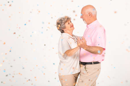 Older married couple dancing together at the party Standard-Bild - 129348488
