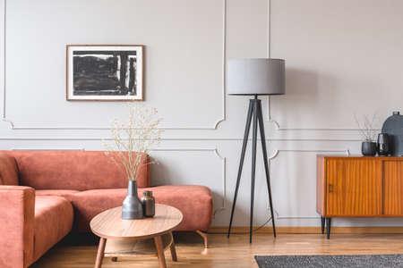 Stylish tall grey lamp in elegant living room interior with comfortable brown corner sofa Stok Fotoğraf