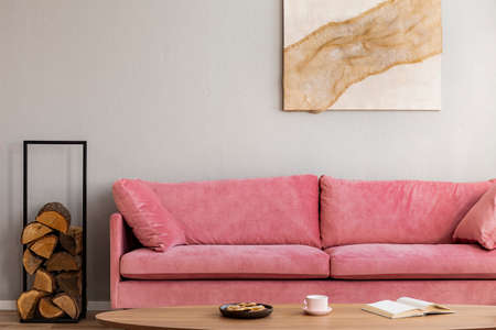 Living room in neutral colors with accents of pink and wood