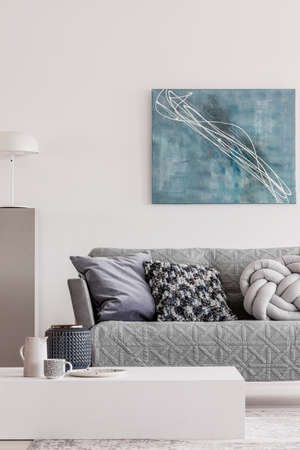 Abstract blue painting on empty white wall of open plan apartment Stok Fotoğraf