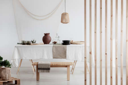 White tablecloth on the table in bright kitchen