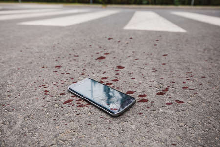 Close-up of the blood on the phone on the street 版權商用圖片