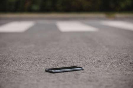 Close-up of lost phone on the street Reklamní fotografie
