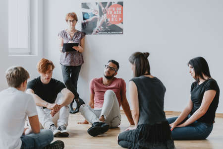 Group of young people during psychotherapy for teenagers