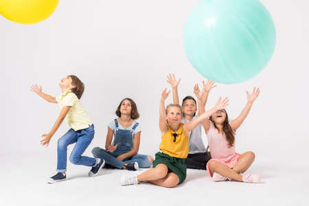 Happy children catching colorful balloons at the party Stock Photo