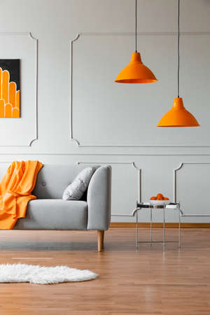 Stylish abstract paining on the wall of trendy living room interior Stockfoto