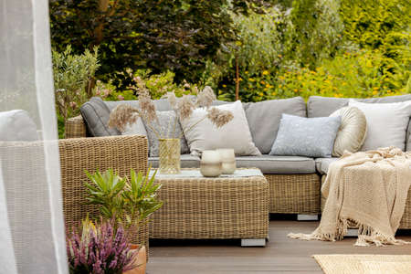 Autumn afternoon on a cozy modern porch with sofa and coffee table