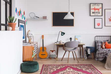 Stylish desk and chair in workspace in vintage genderless kid room