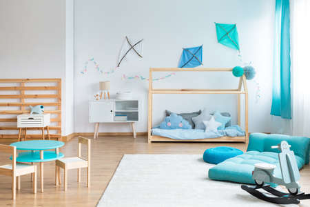Do it yourself blue kites on empty white wall in scandinavian bedroom for kid