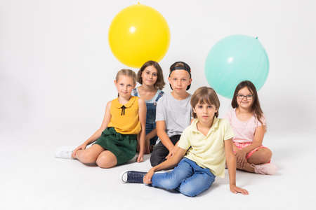 Group of young kids sitting together on a floor Zdjęcie Seryjne
